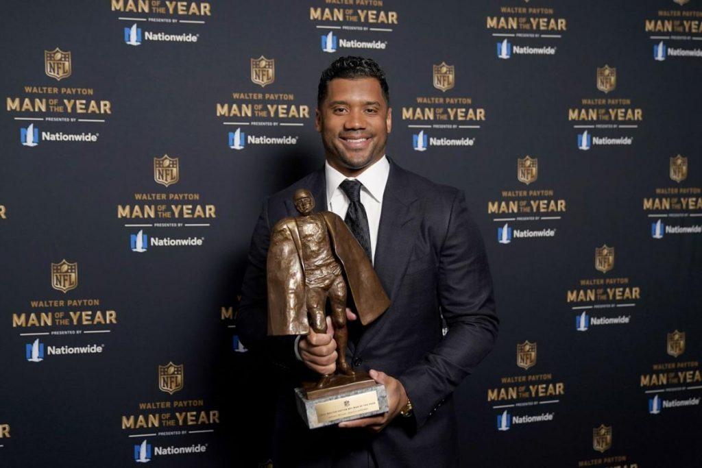 Russell Wilson winning the NFL Walter Payton Man of the Year award.